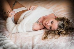 woman wearing slouchy sweater  for Boudoir Photography  session in Lincolnshire