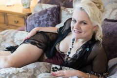 mature woman laying on a bed for Boudoir Photography Lincolnshire