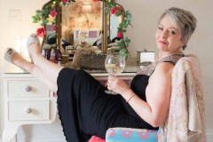 woman in black dress holding gin and tonic for a Boudoir Photograph Lincolnshire