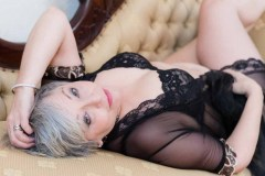 woman lying on a gold chaise longue for a Boudoir Photograph Lincolnshire
