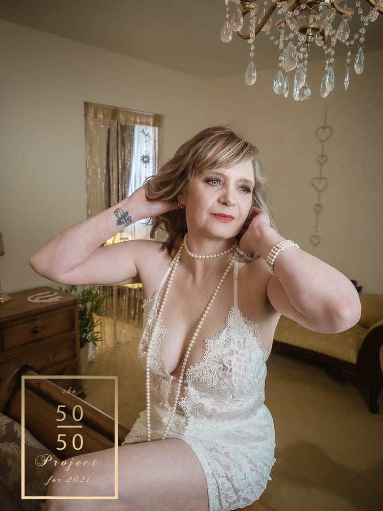 woman in white bodysuit having a boudoir shoot for mature ladies