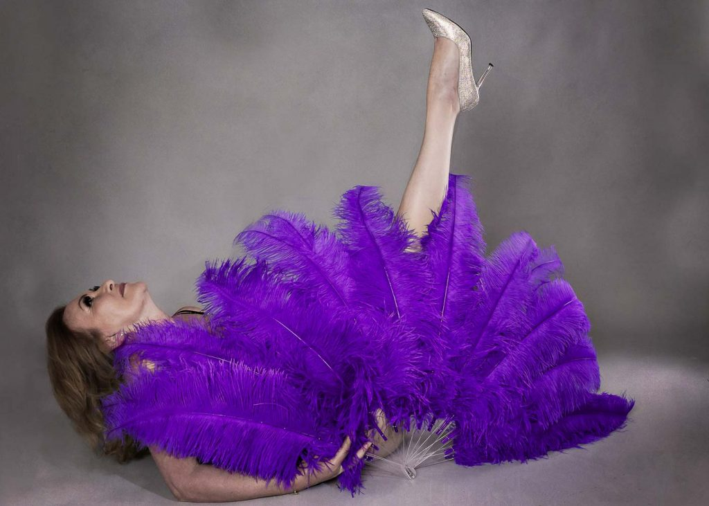 woman with purple burlesque feathers